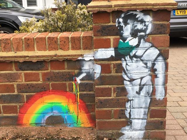 Rainbow boy mural